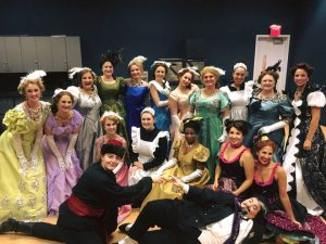 Professional opera company cast members pausing for backstage photo